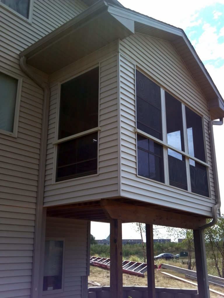 3-Season Enclosed porch with exterior chair rail