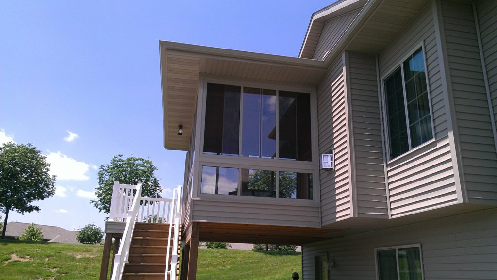 4-season porch with bottom transom windows, exterior deck with PVC railings