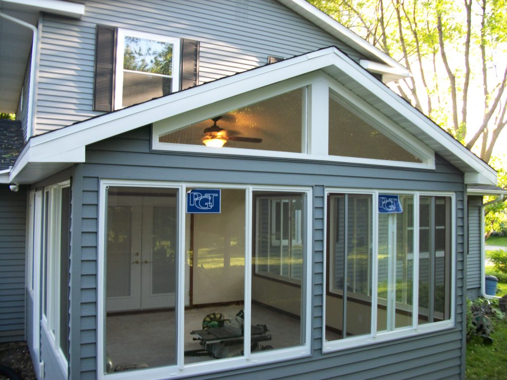 4-season porch with sliding windows and transom triangle windows