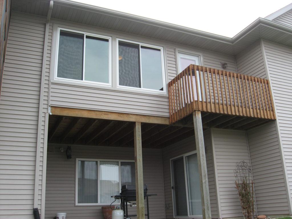 Converted 3-season porch to 4-season porch with sliding windows, deck